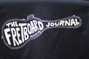 A close-up of The Fretboard Journal t-shirt